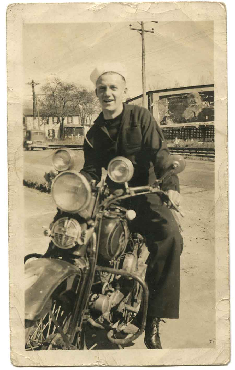Al Bell, M1c, with one of his Indian motorcycles.